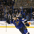 St. Louis Blues defenseman Kevin Shattenkirk raises his stick in celebration after scoring the decisive goal in a shootout during a game between the St. Louis Blues and the Philadelphia Flyers on Tuesday, April 1, 2014, at the Scottrade Center in St. Loui