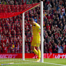Southampton's goalkeeper Fraser Forster reacts after the winning goal by Liverpool's Daniel Sturridge, out of frame, during their English Premier League soccer match at Anfield Stadium, Liverpool, England, Sunday Aug. 17, 2014