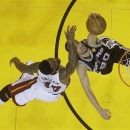 Miami Heat forward Udonis Haslem (40) fouls San Antonio Spurs guard Manu Ginobili (20) of Argentina during the second half of Game 1 of the NBA Finals basketball game, Thursday, June 6, 2013 in Miami. The Spurs defeated the Heat 92-88. (AP Photo/Lynne Sladky)