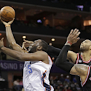 Charlotte Bobcats' Al Jefferson, left, shoots past Charlotte Bobcats' Jannero Pargo, right, and Taj Gibson, second from right, during the first half of an NBA basketball game in Charlotte, N.C., Wednesday, April 16, 2014. (AP Photo/Chuck Burton)