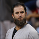 Boston Red Sox's Mike Napoli stands in the dugout before a baseball game against the Pittsburgh Pirates in Pittsburgh Tuesday, Sept. 16, 2014 The Associated Press