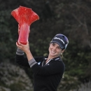 Beatriz Recari, of Spain, holds up the trophy after winning the LPGA golf tournament at Aviara Golf Club, Sunday, March 24, 2013 in Carlsbad, Calif. (AP Photo/Denis Poroy)