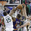 Utah Jazz's Derrick Favors (15) and teammate Gordon Hayward, right, block the shot of Phoenix Suns' Markieff Morris (11) in the second half of an NBA basketball game on Wednesday, Feb. 26, 2014, in Salt Lake City. The Jazz won 109-86 The Associated Press