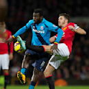 Stoke's Mame Diouf, left, fights for the ball against Manchester United's Michael Carrick during the English Premier League soccer match between Manchester United and Stoke City at Old Trafford Stadium, Manchester, England, Tuesday Dec. 2, 2014