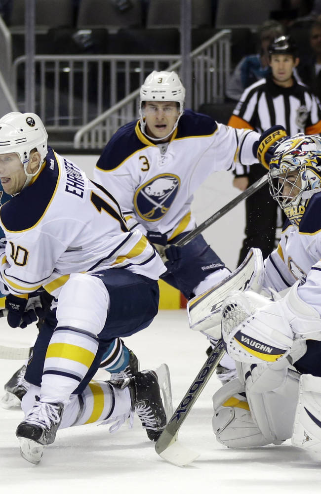 San Jose Sharks' Patrick Marleau, left, tries to shoot past Buffalo Sabres' Christian Ehrhoff (10), of Germany, and goalie Ryan Miller, right, during the first period of an NHL hockey game Tuesday, Nov. 5, 2013, in San Jose, Calif