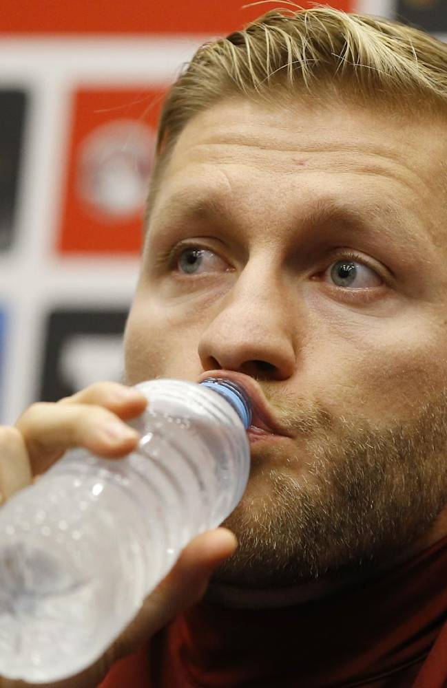 Poland's soccer team captain Jakub Blaszczykowski takes a drink during a press conference at Wembley Stadium in London, Monday, Oct. 14, 2013. England will play Poland in a World Cup Group H qualification match at Wembley stadium on Tuesday