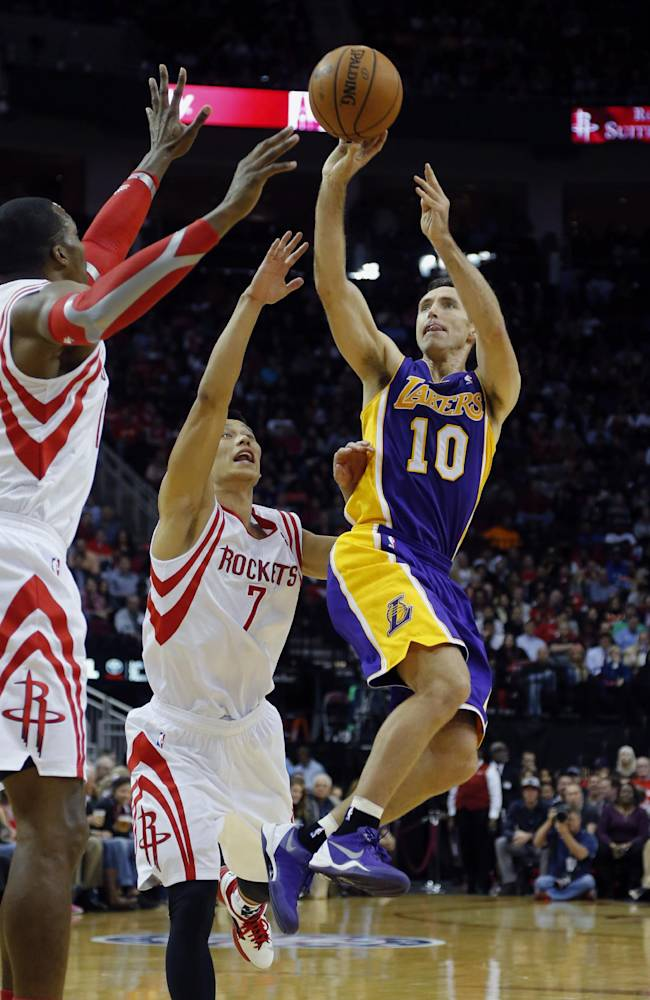 Los Angeles Lakers' Steve Nash (10) goes up for a shot as Houston Rockets' Jeremy Lin (7) and Dwight Howard, left, defend during the first quarter of an NBA basketball game Thursday, Nov. 7, 2013, in Houston