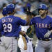 Texas Rangers' Mitch Moreland, right, is congratulated by Adrian Beltre (29) after Moreland hit a two-run home run off Oakland Athletics' Bartolo Colon in the fourth inning of a baseball game Tuesday, May 14, 2013, in Oakland, Calif. (AP Photo/Ben Margot)