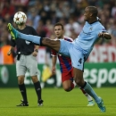 Manchester City's Vincent Kompany kicks the ball during the Champions League Group E soccer match between FC Bayern Munich and Manchester City at Allianz Arena in Munich, southern Germany, Wednesday Sept. 17, 2014