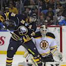Buffalo Sabres left winger Matt Moulson (26) raises his stick to deflect the puck in front of Boston Bruins goaltender Niklas Svedberg (72), of Sweden, during the first period of an NHL hockey game Thursday, Oct., 30, 2014, in Buffalo, N.Y. (AP Photo/Gary Wiepert)