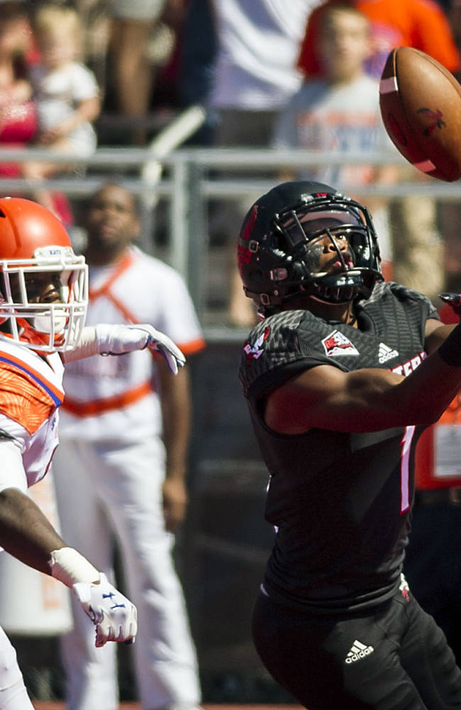 Eastern Washington cornerback Shaq Hill, right, lets the ball slip through his fingers for an incomplete pass against Sam Houston State in the first half of an NCAA college football game in Cheney, Wash., Saturday, Aug. 23, 2014