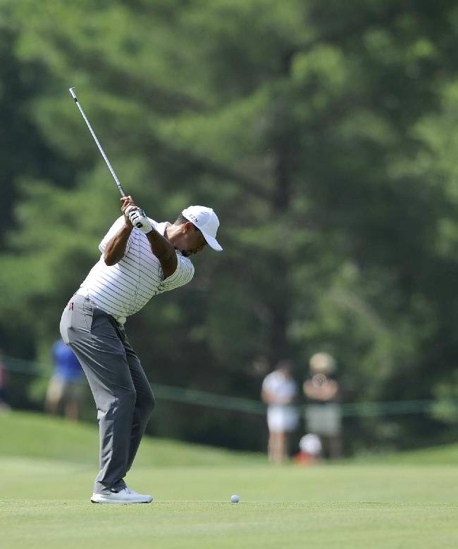 Tiger Woods hits on the fifth fairway during the Pro-Am at the Quicken Loans National golf tournament, Wednesday, June 25, 2014, in Bethesda, Md