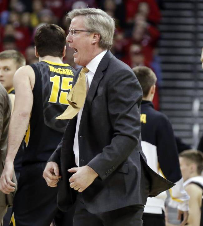 Iowa coach Fran McCaffery, center, argues a call during the second half of an NCAA college basketball game against Wisconsin, Sunday, Jan. 5, 2014, in Madison, Wis. McCaffery was ejected from the game and Iowa was charged with two technical fouls. Wisconsin won 75-71