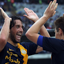 Hellas Verona's Luca Toni, left, celebrates with his teammate Michelangelo Albertazzi after scoring during a Serie A soccer match against AC Milan at the Bentegodi stadium in Verona, Italy, Saturday, Aug. 24, 2013. Luca Toni scored twice and Hellas Verona beat AC Milan 2-1 Saturday to celebrate its return to Serie A after an 11-year absence as the Italian league opened with a shock. After Andrea Poli put Milan ahead in the 14th minute following a pass from Mario Balotelli, the 1.96-meter (6-foot-5) Toni struck back with headers in the 30th and 53rd minutes at the Bentegodi stadium. (AP Photo/Felice Calabro')