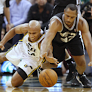 San Antonio Spurs Boris Diaw, left, and Utah Jazz's Richard Jefferson dive for a loose ball during the first half of an NBA basketball game in Salt Lake City, Friday, Nov. 15, 2013. (AP photo/George Frey) The Associated Press