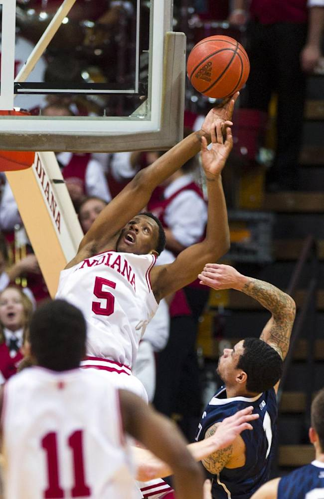 Indiana's Troy Williams (5) is fouled by Penn State's John Johnson in the first half of an NCAA college basketball game Wednesday, Feb. 12, 2014, in Bloomington, Ind