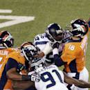 FILE - In this Feb. 2, 2014, file photo, Denver Broncos' Peyton Manning is hit by Seattle Seahawks' Cliff Avril (56) during the first half of the NFL Super Bowl XLVIII football game in East Rutherford, N.J. One of the hallmarks of the Seahawks' Super Bowl run was the ability to wreak havoc on quarterbacks but this season Seattle's pass rush is not close to matching its effectiveness from last year. (AP Photo/Charlie Riedel, File)