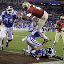 Florida State's Jameis Winston, top center, leaps over Duke's Bryon Fields (14) for a touchdown in the second half of the Atlantic Coast Conference Championship NCAA football game in Charlotte, N.C., Saturday, Dec. 7, 2013. Florida State won 45-7 The Asso