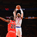 NEW YORK, NY - DECEMBER 11: Carmelo Anthony #7 of the New York Knicks shoots against Tony Snell #20 of the Chicago Bulls during the game on December 11, 2013 at Madison Square Garden in New York City, New York. (Photo by Jesse D. Garrabrant/NBAE via Getty Images)