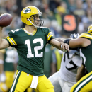 Green Bay Packers quarterback Aaron Rodgers (12) throws a pass against the Oakland Raiders during the first quarter of an NFL preseason football game Friday, Aug. 22, 2014, in Green Bay, Wis The Associated Press