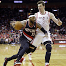 Portland Trail Blazers' Mo Williams (25) drives toward the basket as Houston Rockets' Omer Asik (3) defends during the first quarter of an NBA basketball game on Sunday, March 9, 2014, in Houston The Associated Press
