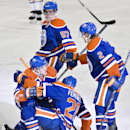 Edmonton Oilers' Leon Draisaitl (29), Andrew Ference (21), David Perron (57) and Jeff Petry (2) celebrate a goal against the Carolina Hurricanes during the third period of an NHL hockey game Friday, Oct. 24, 2014, in Edmonton, Alberta. The Oilers won 6-3