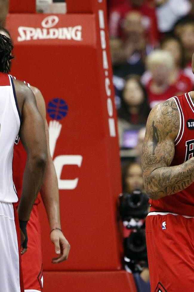 Chicago Bulls forward Carlos Boozer (5) reacts to a foul call, with Washington Wizards forward Nene (42) nearby in the second half of Game 3 of an opening-round NBA basketball playoff series, Friday, April 25, 2014, in Washington. The Bulls won 100-97