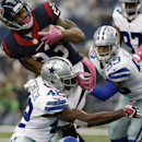 Houston Texans' Arian Foster (23) is tackled on a running play by Dallas Cowboys' Barry Church (42), as Brandon Carr (39) and Terrell McClain (97) watch during the first half of an NFL football game, Sunday, Oct. 5, 2014, in Arlington, Texas The Associate
