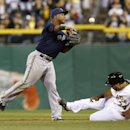 Pittsburgh Pirates' Pedro Alvarez, right, slides to second as Milwaukee Brewers shortstop Jean Segura, left, throws to first to complete the double play on Jose Tabata in the ninth inning of a baseball game on Saturday, April 19, 2014, in Pittsburgh. The