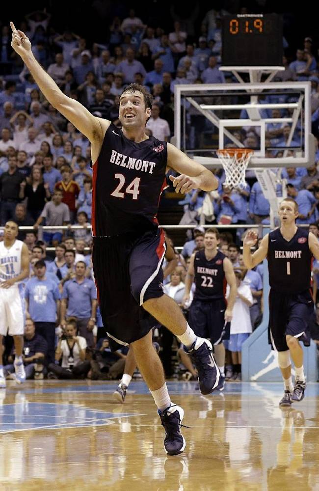 In this Nov. 17, 2013 file photo, Belmont's J.J. Mann (24) celebrates near the end of an NCAA college basketball game against North Carolina in Chapel Hill, N.C., Belmont upset North Carolina 83-80