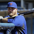 New York Mets' Lucas Duda leans against a batting cage during spring training baseball practice Friday, Feb. 14, 2014, in Port St. Lucie, Fla The Associated Press