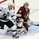 Arizona Coyotes goalie Devan Dubnyk (40) makes the save in front of Los Angeles Kings left wing Dwight King (74) in the third period during an NHL hockey game, Thursday, Dec. 4, 2014, in Glendale, Ariz The Associated Press