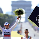 BMC Racing Team rider and best young rider white jersey holder Tejay Van Garderen of the U.S. celebrates on the podium after the final 20th stage of the 99th Tour de France cycling race in Paris July 22, 2012.     REUTERS/Jerome Prevost/Pool