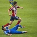 Montreal Impact's Andres Romero, bottom, is challenged by Chivas USA's Carlos Borja during the first half of an MLS soccer action in Montreal, Sunday, July 7, 2013. (AP Photo/The Canadian Press, Graham Hughes)