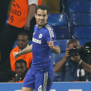Chelsea's Cesc Fabregas celebrates after scoring the opening goal during the Champions League group G soccer match between Chelsea and Schalke 04 at Stamford Bridge stadium in London, Wednesday, Sept. 17, 2014