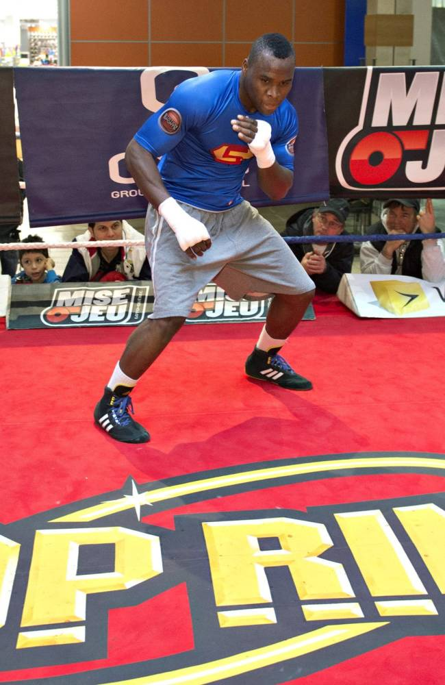 WBC light heavyweight champion Adonis Stevenson shadow boxes during a public training session Tuesday, Nov. 26, 2013 in Quebec City. Stevenson will slated to defend his title against Tony Bellew of England,on Saturday in Quebec City