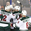 Minnesota Wild's Nino Niederreiter (22), Charlie Coyle (3), Jared Spurgeon, Ryan Carter, second from right, and Marco Scandella (6) celebrate a goal against the Edmonton Oilers during the third period of an NHL hockey game Tuesday, Jan. 27, 2015, in Edmon
