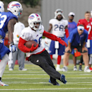 Buffalo Bills running back C.J. Spiller (28) runs past safety Aaron Williams (23) during their NFL football training camp in Pittsford, N.Y., Sunday, July 20, 2014 The Associated Press