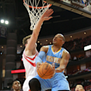 Denver Nuggets guard Randy Foye goes up for a shot against Houston Rockets center Omer Asik as Rockets' Terrence Jones and Jeremy Lin, right, watch during the first half of an NBA basketball game in Houston on Sunday, April 6, 2014 The Associated Press