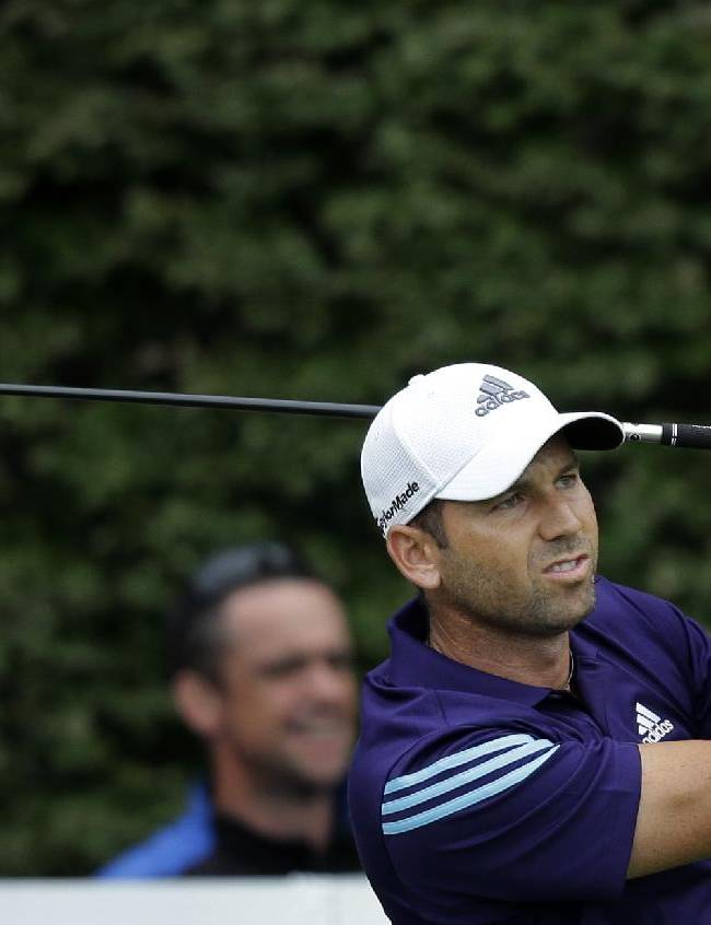 Sergio Garcia, of Spain, watches his tee shot on the 17th hole during the second round of play at The Barclays golf tournament Friday, Aug. 22, 2014, in Paramus, N.J