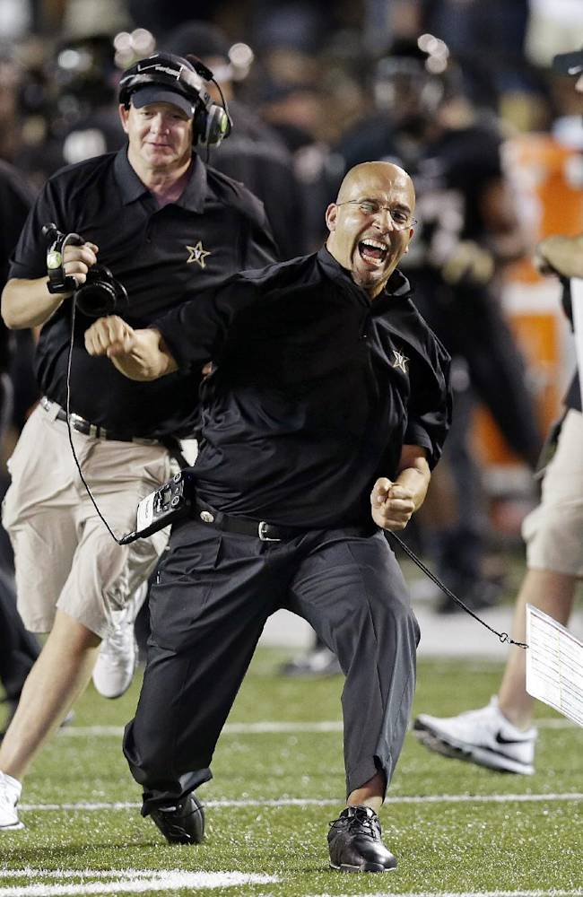 In this Aug. 30, 2013 file photo, Vanderbilt head coach James Franklin, center, celebrates after Vanderbilt took the lead against Mississippi during the fourth quarter of an NCAA college football game in Nashville, Tenn. Penn State has hired Franklin as its next head coach. Franklin, 41, who led Vanderbilt to bowls in all three of his seasons there, replaces Bill O'Brien, who left the Nittany Lions after two years to coach the NFL's Houston Texans. Penn State made the announcement Saturday, after the school's compensation committee met to finalize the contract