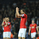 Manchester United's goal scorer Daley Blind applauds fans after the English Premier League soccer match between West Bromwich Albion and Manchester United at the Hawthorns, Birmingham, England, Monday, Oct. 20, 2014