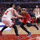 Washington Wizards guard John Wall, right, drives on Chicago Bulls guard Kirk Hinrich (12) during the first half of Game 2 in an opening-round NBA basketball playoff series Tuesday, April 22, 2014, in Chicago The Associated Press