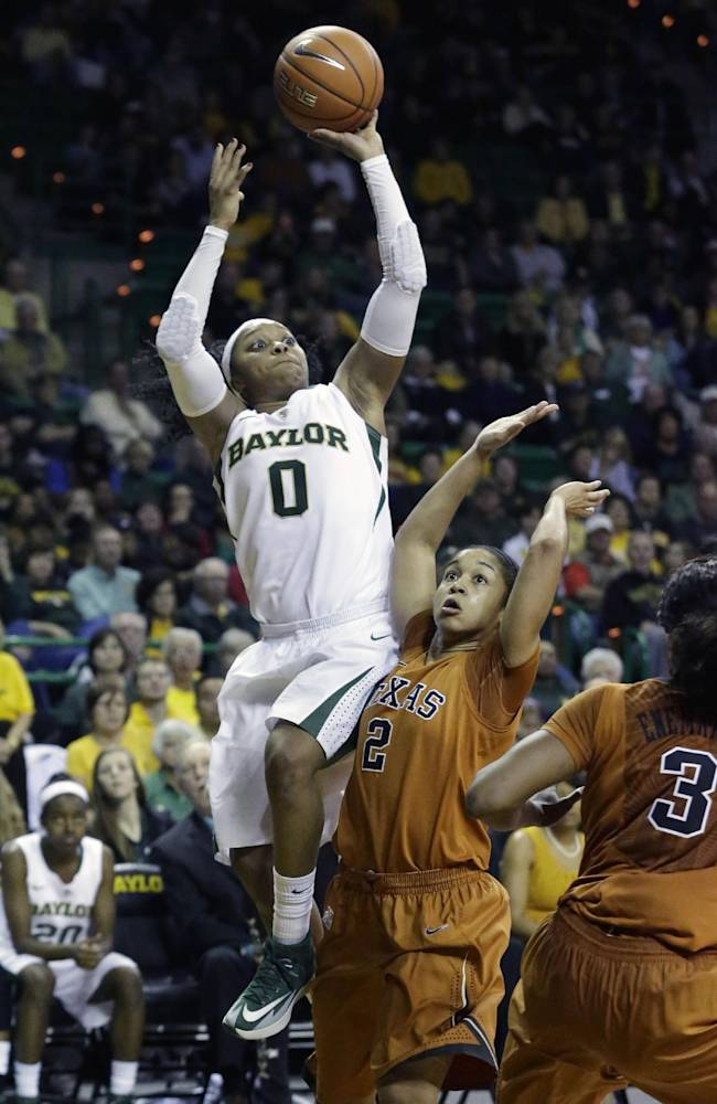 Baylor guard Odyssey Sims (0) shoots against Texas guard Celina Rodrigo (2) during the second half of an NCAA college basketball game, Saturday, Feb. 1, 2014, in Waco, Texas. Sims scored 44 points in the Baylor 87-73 win