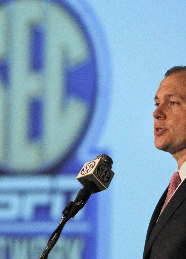 Justin Connolly, from the SEC Network, speaks to the media at the Southeastern Conference NCAA college football media days, Wednesday, July 16, 2014, in Hoover, Ala