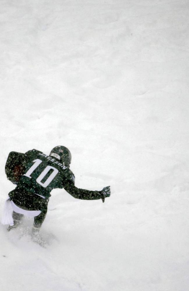 Philadelphia Eagles' DeSean Jackson celebrates in the snow after a touchdown during the second half of an NFL football game against the Detroit Lions, Sunday, Dec. 8, 2013, in Philadelphia