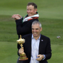 Europe team captain Paul McGinley holds the trophy as Jamie Donaldson makes a joke at the rear after winning the 2014 Ryder Cup golf tournament at Gleneagles, Scotland, Sunday, Sept. 28, 2014. (AP Photo/Matt Dunham)