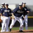 San Diego Padres pitcher Josh Johnson sprints off the pitchers mound to field a ground ball during spring training baseball practice Sunday, Feb. 16, 2014, in Peoria, Ariz The Associated Press