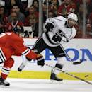FILE - In this May 28, 2014, file photo, Los Angeles Kings center Mike Richards (10) keeps the puck away from Chicago Blackhawks defenseman Duncan Keith (2) during a power play in the first period in Game 5 of the Western Conference finals in the NHL hockey Stanley Cup playoffs in Chicago. The Los Angeles Kings released Richards on Monday, Jan. 26, 2015. (AP Photo/Nam Y. Huh, File)