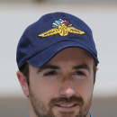 James Hinchcliffe, of Canada, poses for a photo after his qualification run on the first day of qualifications for Indianapolis 500 IndyCar auto race at the Indianapolis Motor Speedway in Indianapolis, Saturday, May 17, 2014. (AP Photo/Dave Parker)